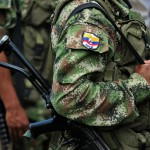 Members of the Revolutionary Armed Forces of Colombia (FARC) guerrillas, guard the mountainous region of the department of Cauca, around Montealagre, Colombia, on February 15, 2013 after they released Colombian police officers Victor Alfonso Gonzalez and Cristian Camilo Yate. Leftist Colombian guerrillas on Friday released two police officers they had held for three weeks, the International Committee of the Red Cross said. The men were released in a rural area in Cauca department in southwestern Colombia and were in good health, the ICRC said in a statement.  AFP PHOTO / LUIS ROBAYO        (Photo credit should read LUIS ROBAYO/AFP/Getty Images)